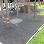 Evenwood Primary School, wooden play frame and swings.