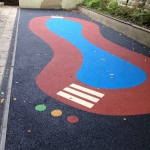 Coloured safety surfacing