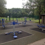 Bonded rubber mulch around outdoor gym equipment.