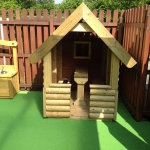 Wooden play shelter.