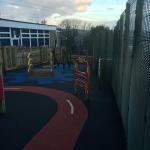 Finished coloured surfacing and play equipment.