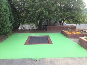 Trampoline and safety surface