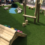 Tunnel, climbing frames on artificial grass.