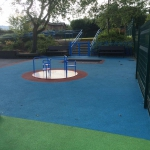 Finished playground with roundabout, North West, UK.
