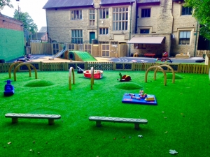 Colourful playground and artificial grass, Manchester.